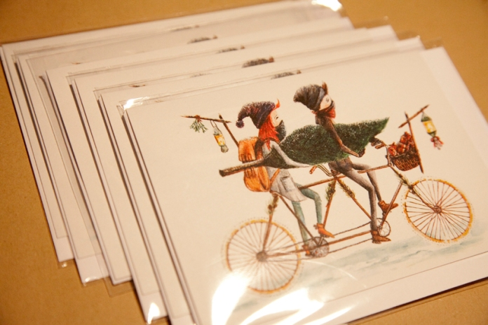 Tandem Bicycle spreads Christmas Cheer // plastic